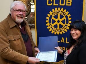 Teresa Zettler holding her certificate
